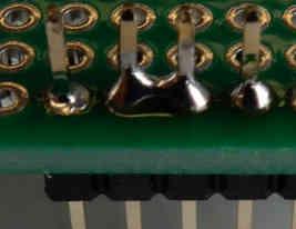 removing solder bridge